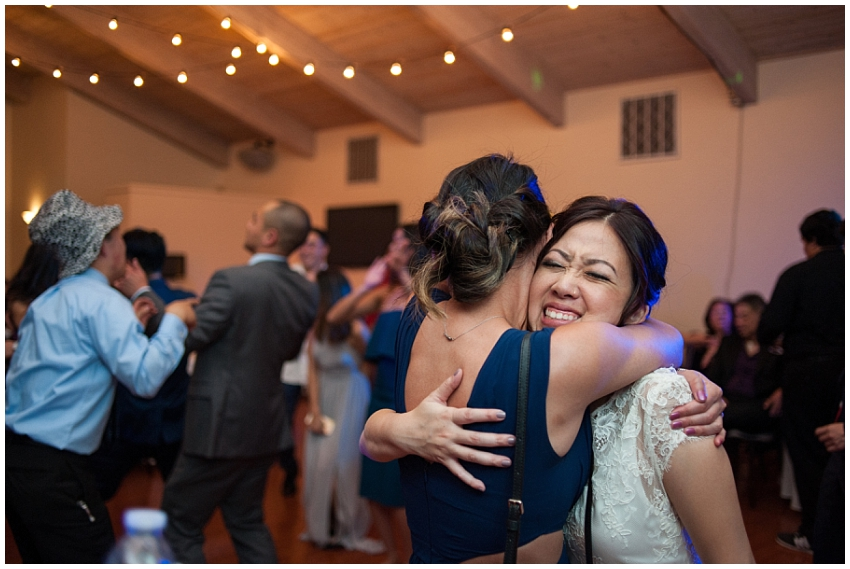 Bride hugging wedding guest in Sunol, CA