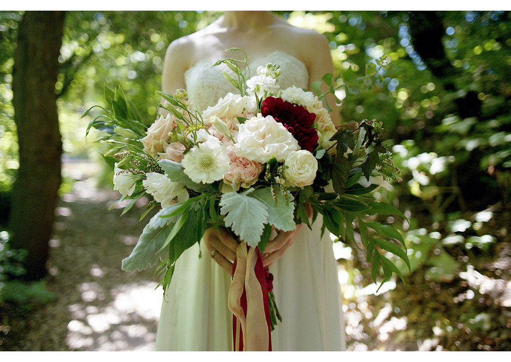 Detail photo of bride holding large flower bouquet