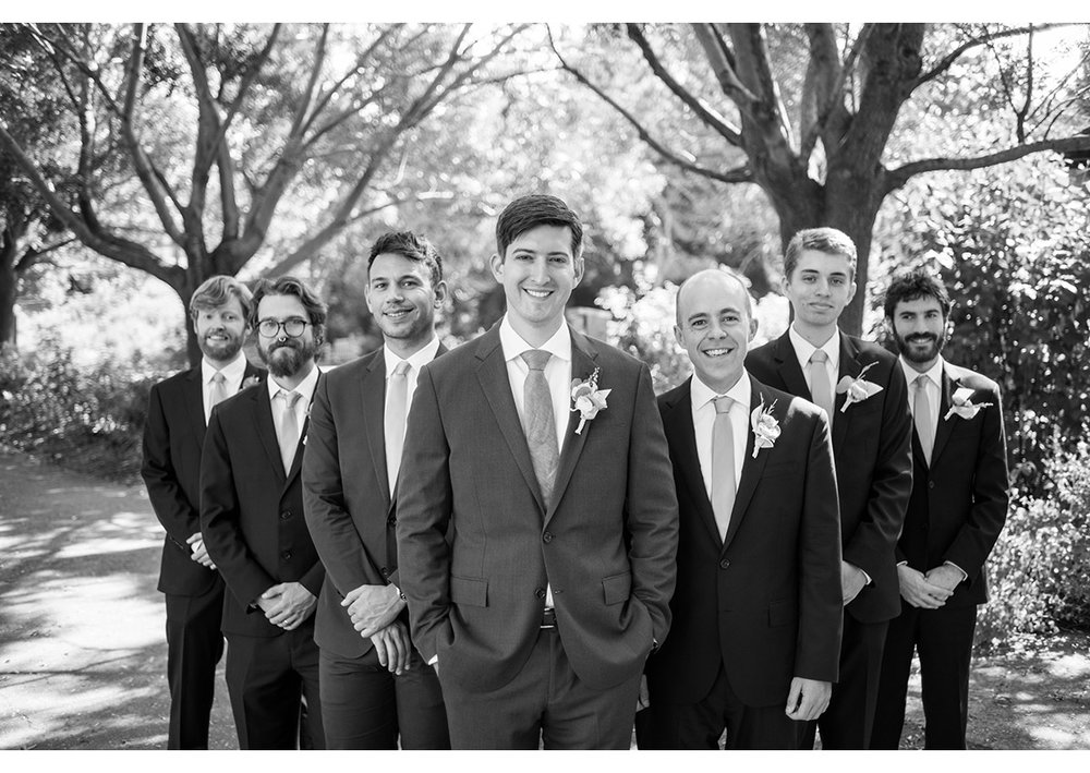 Black and white of groom and groomsmen