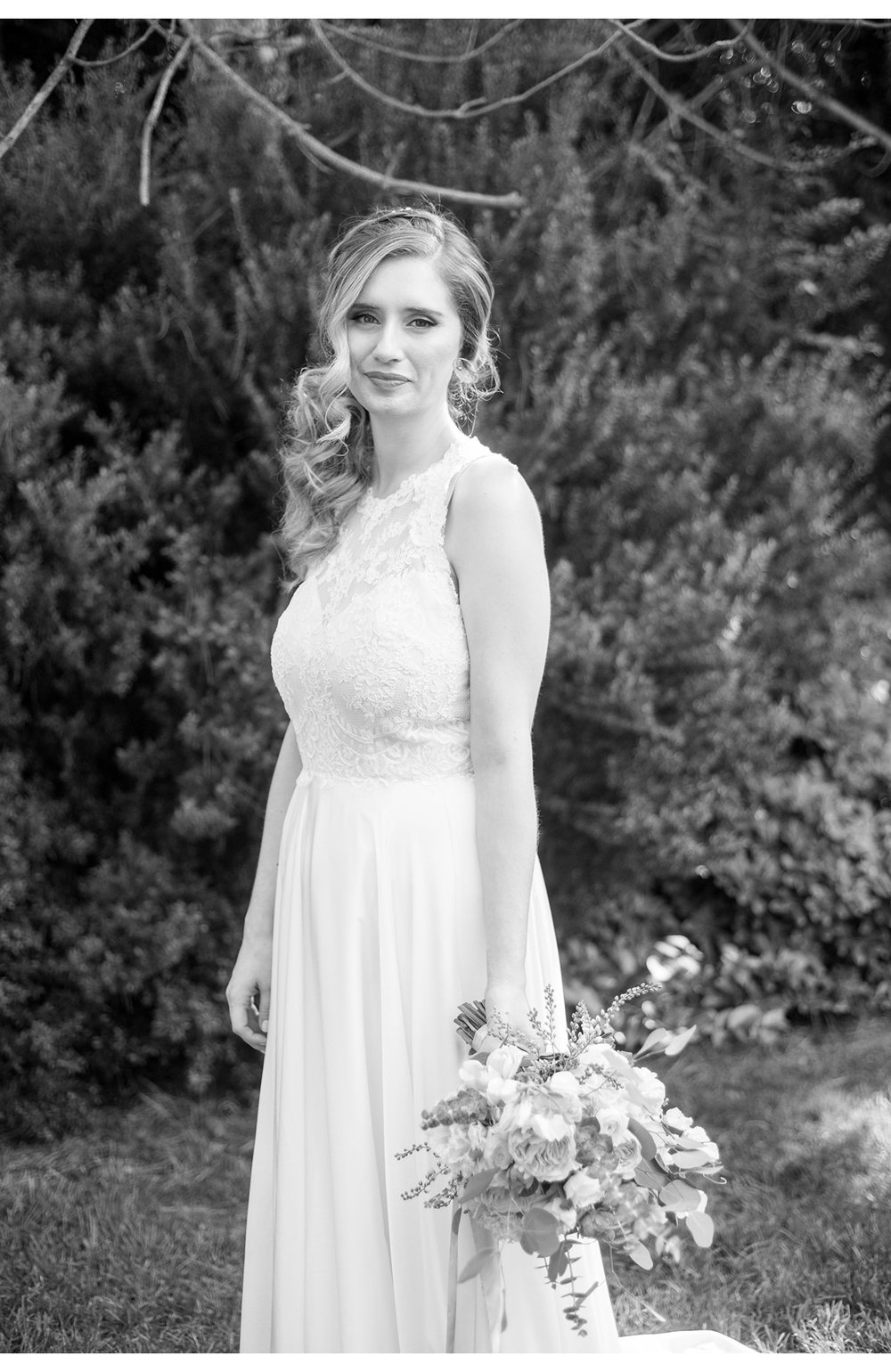 Black and white portrait of bride holding bouquet