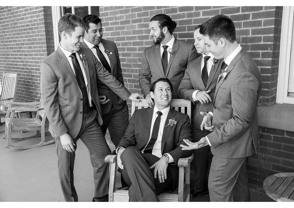 Groom surrounded by groomsmen in Presidio
