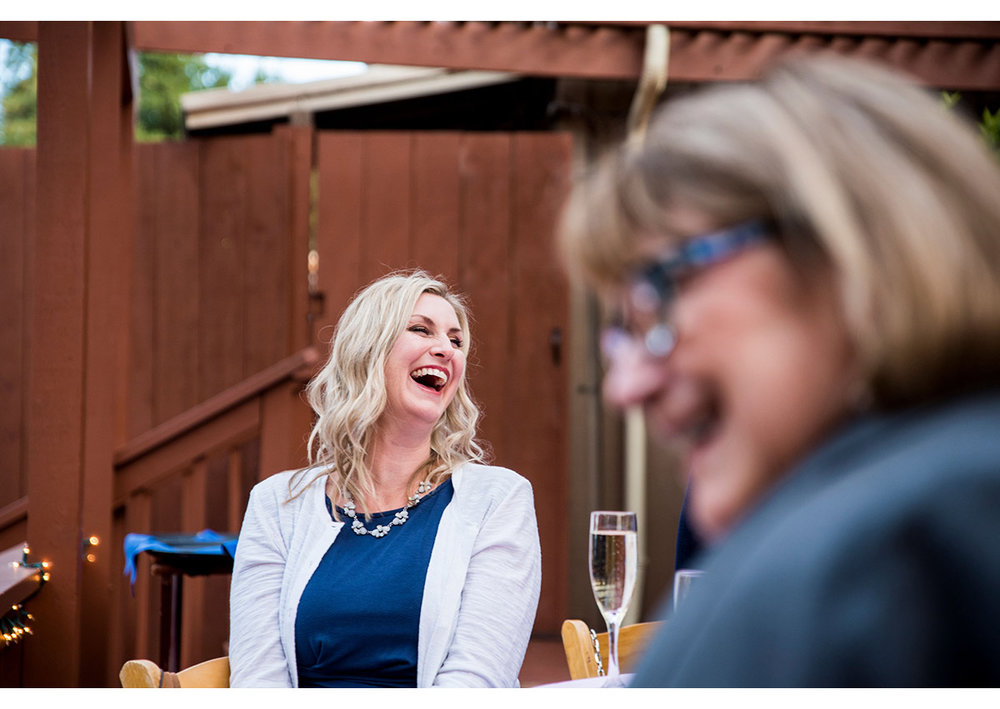 Wedding guest laughing during toast at the Mountain Terrace