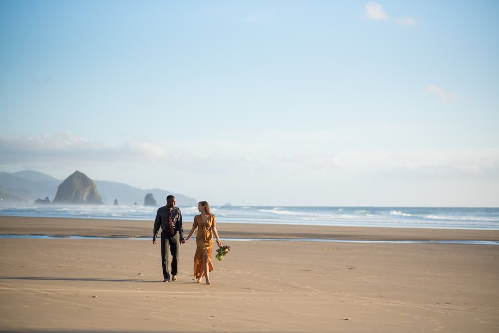 Bride and Groom walking on Cannon Beach