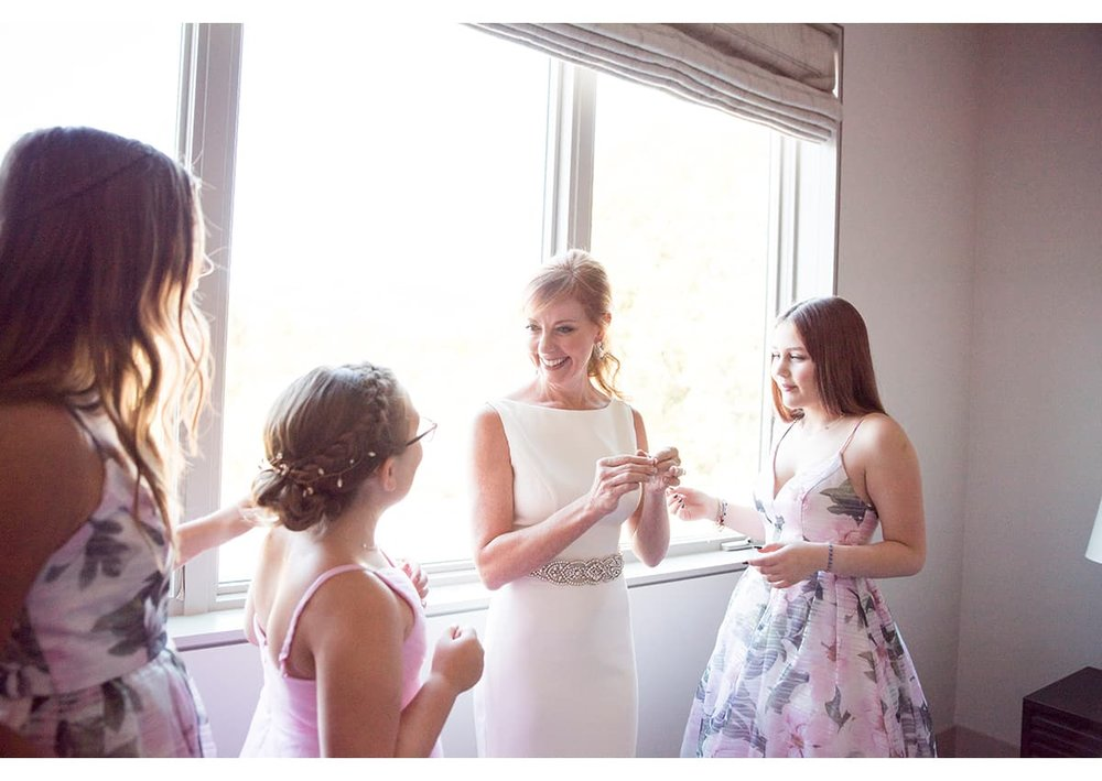 Bride and her daughters getting ready for Sonoma wedding