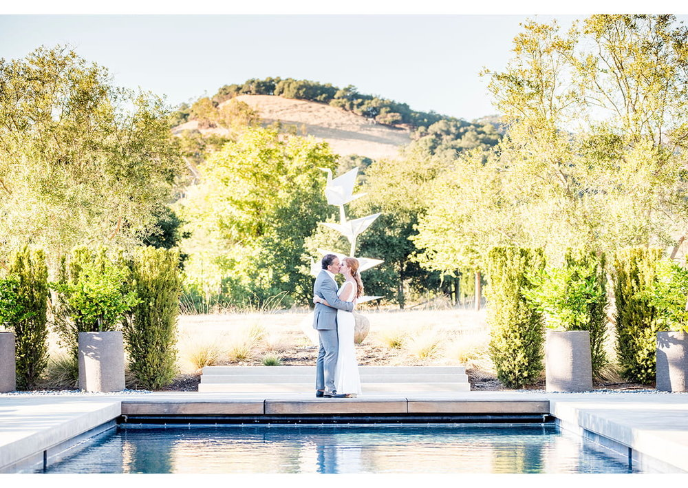 Bride and Groom kiss at the end of pool