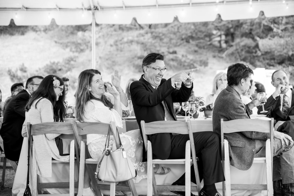 Wedding guests reacting to toasts