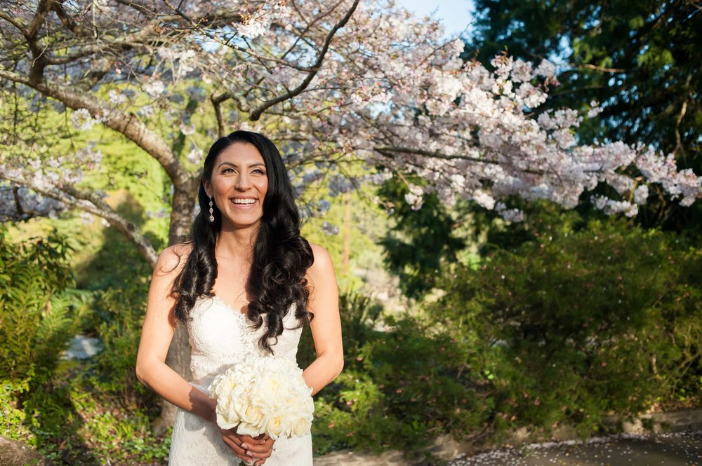 Portrait of bride under cherry blossom tree at Brazilian Room