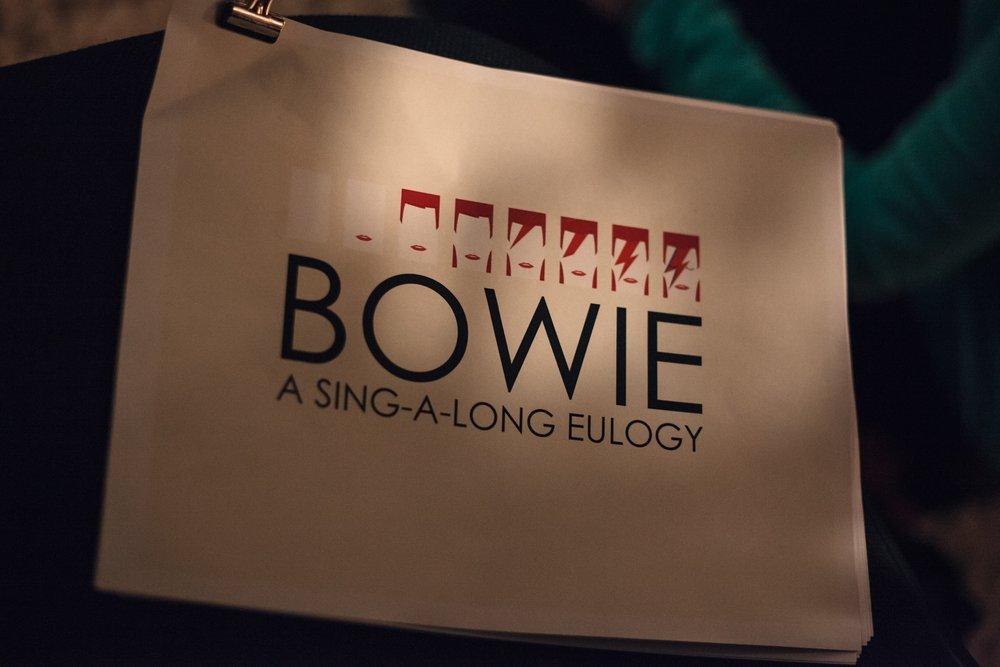 Bowie Sing A-long Euology  Bowie's death was shattering, our answer to the grief was to bring together musicians and community members to spend an evening singing his songs, accompanied by the Seattle Rock Orchestra