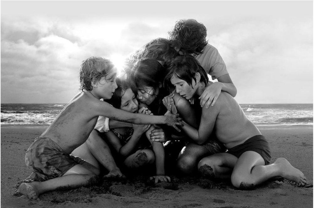 W A T C H:If you haven't seen ROMA, I urge you NOT to see it. Not to see it on Netflix, that is. This larger-than-life film, set in Mexico City in the 1970s, deserves the largest screen you can find -- so please, do this film the justice it deserves. The pickings of cinemas where you can actually watch Roma are slim right now. There was a brief stint at Cinerama, but thanks to its 10 Academy Award nominations, most notably its nomination for Best Picture, it will likely be played at Cinerama again and is also currently showing at Landmark's Crest Cinema Center and Ark Lodge Cinemas.And I don't mean to sound like a broken record here. Everyone is talking about this film's release on Netflix, but what reviewers should be leading with is the film's inherent magic. Cuaron has created a beautiful portrait of humanity, which is a tribute to his childhood caregiver and nanny, Libo, who watched his family survive a divorce and helped carry them through various resulting traumas.The film is stripped down, filmed in black and white and without any kind of soundtrack. And what many people may not realize is that Cuaron, who wrote, directed, and shot this film, made a series of directorial choices that, in my opinion, helped suffuse the film with an inherent magic. I'd describe this on-screen magic as a kind of mystical, natural elegance. Cuaron gave the actors no script. He barely gave them a plot. During filming, he'd pull each individual actor aside each day (most of them not real actors but playing their real-life roles as doctors, nurses, maids, passers-by, etc.), and give them little bits of information, weaving stories and secrets into the individual actor's own context for the filming that would happen that day. The heroine, Cleo, was cast in a small Oaxacan village and had never acted before. Cuaron saw in her a strength that immediately reminded him of Libo, the real-life inspiration for the film.As a child, Cuaron dreamed of being an astronaut or pilot. Cuaron has re