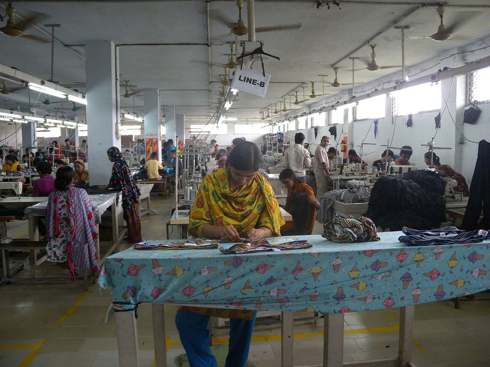 A clothing textile garment factory / assembly line in Bangladesh. Photo by:  Tareq Salahuddin