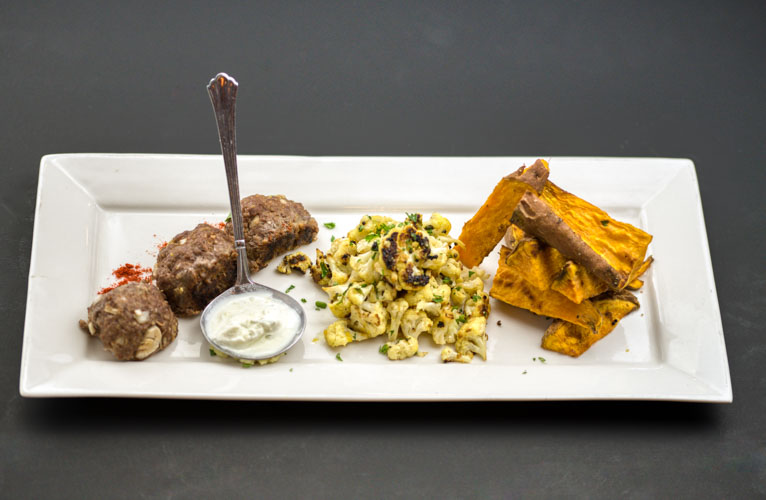 Indian spiced lamb meat balls - with cilantro-jalapeno-lemon seared cauliflower and Garam Masala spiced sweet potato wedge 'fries' and DF coconut yogurt dip.NF P1 Small- $13- (4 oz. lamb, 2 oz. sweet potatoes, 2 oz cauliflower and 2 oz. yogurt sauce1 Large- $22 (6 oz. Lamb, 4 oz. sweet potatoes, 4 oz. Cauliflower and 4 oz. yogurt sauce2 Large packed together for one reduced price- $40For a Vegan version sub power-plant balls for the lamb- the sides are vegan. Same price, but they contain nuts*