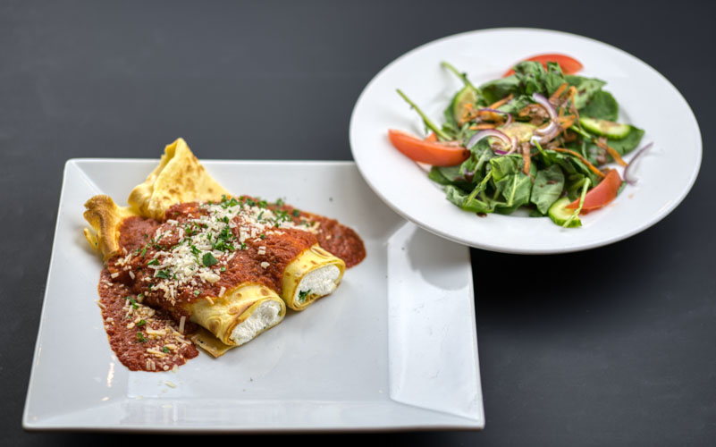Vegetarian Lasagna cannelloni - with a good and basic side saladNF CF V KF1 Small- $14 (1 crepe, 4 oz. spinach & cheeses, topped with 4 oz. tomato sauce plus small salad and 1 oz. Italian vinaigrette)1 Large- $20 (2 crepe, 8 oz. spinach & cheeses, topped with 8 oz. tomato sauce plus side salad and 2 oz. Italian vinaigrette)2 Large packed together for one reduced price- $38