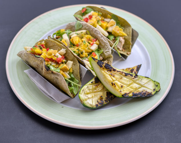 Cajun grilled tacos on plantain shells with choice of chicken, pork loin or cajun sautéed jackfruit - with mango-jicama salsa, arugula and a side of grilled vegetablesP KF1 Small- $14 (3 plantain shells, 3 oz. protein, 4 oz. salsa, 1 oz. arugula, 3 oz. grilled vegetables)1 Large- $26 (8 plantain shells, 7 oz. protein, 7 oz. salsa, 2 oz. arugula, 6 oz. grilled vegetables)2 Large packed together for one reduced price- $47