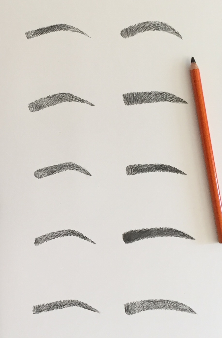 Examples of some of Dr. Champagne's hand-drawn eyebrow shapes.