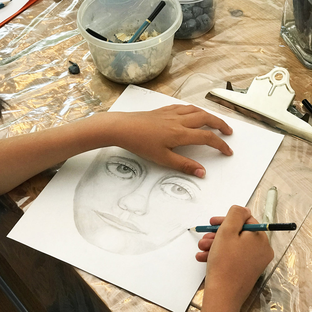 Boy drawing face.jpg