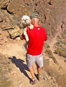 Chloe Smith gets a lift down the Misery Ridge Trail at Smith Rock State Park