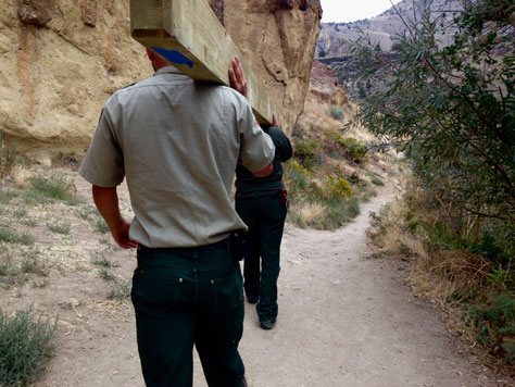 Smith Rock park staff installing trail monitors