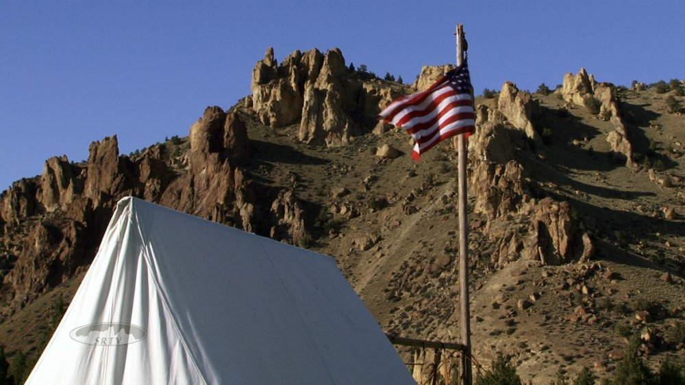 tent and U.S. flag from Oregon 150 lore celebration at Smith Rock State Park