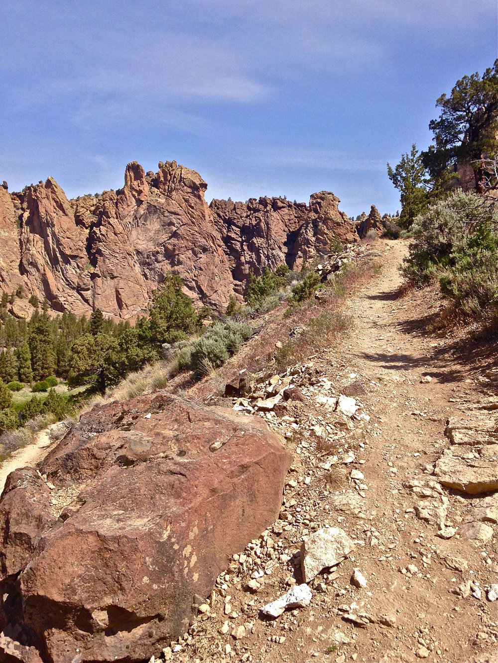 Start of steep section of Homestead Trail on standard route with Monument area in the backround at Smith Rock State Park.