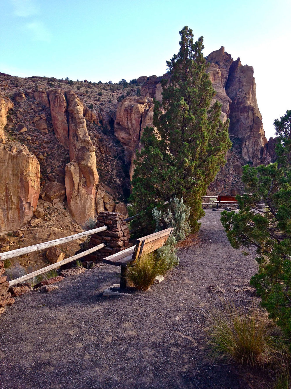 Viewing bench for seeing rock climbers, wildlife, mountain and canyon views along Rim Rock Trail at Smith Rock State Park.