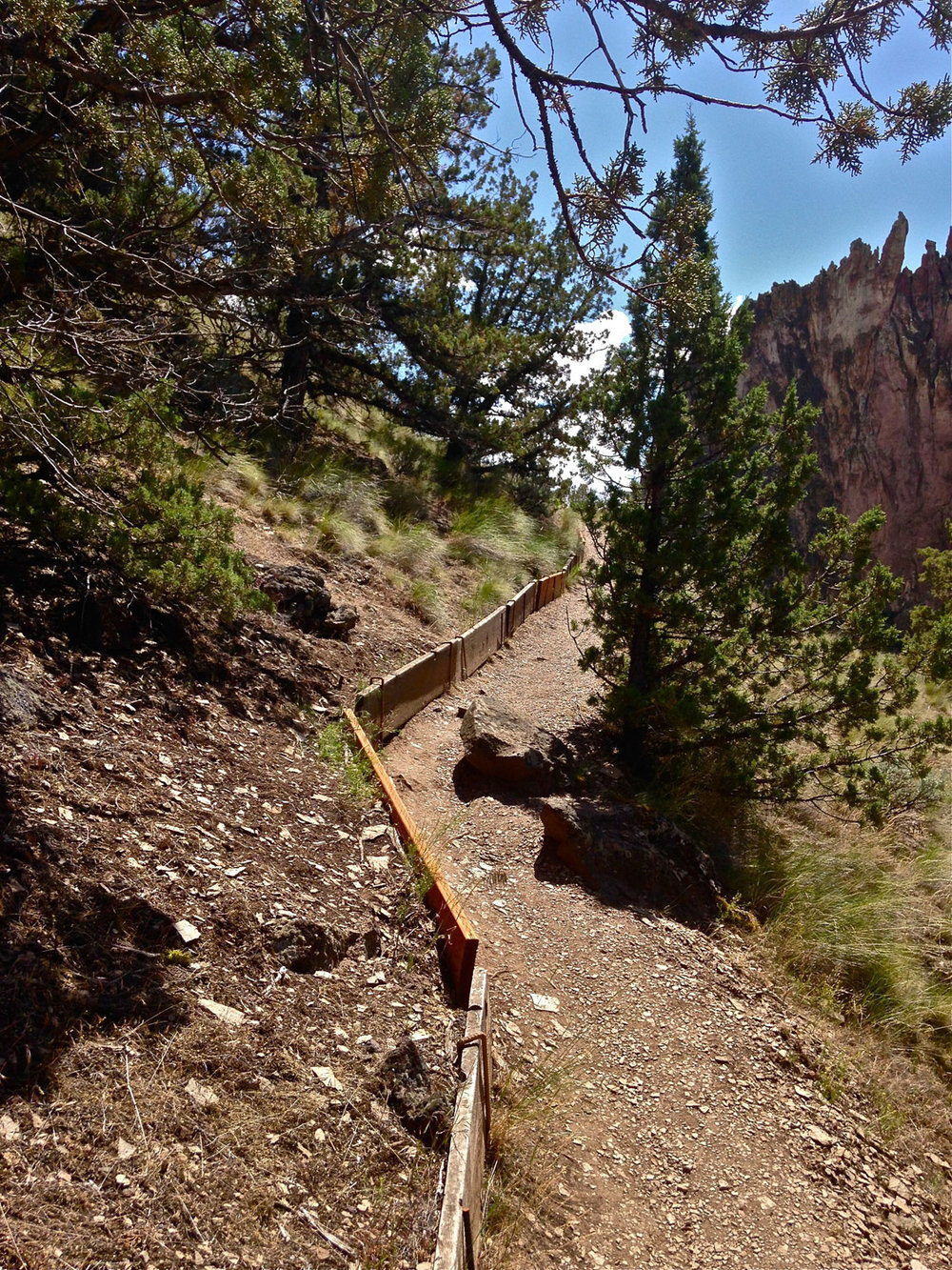 Stairs lead to a scree trail as the Rope-de-Dope Trail heads up out of the river canyon at Smith Rock State Park.