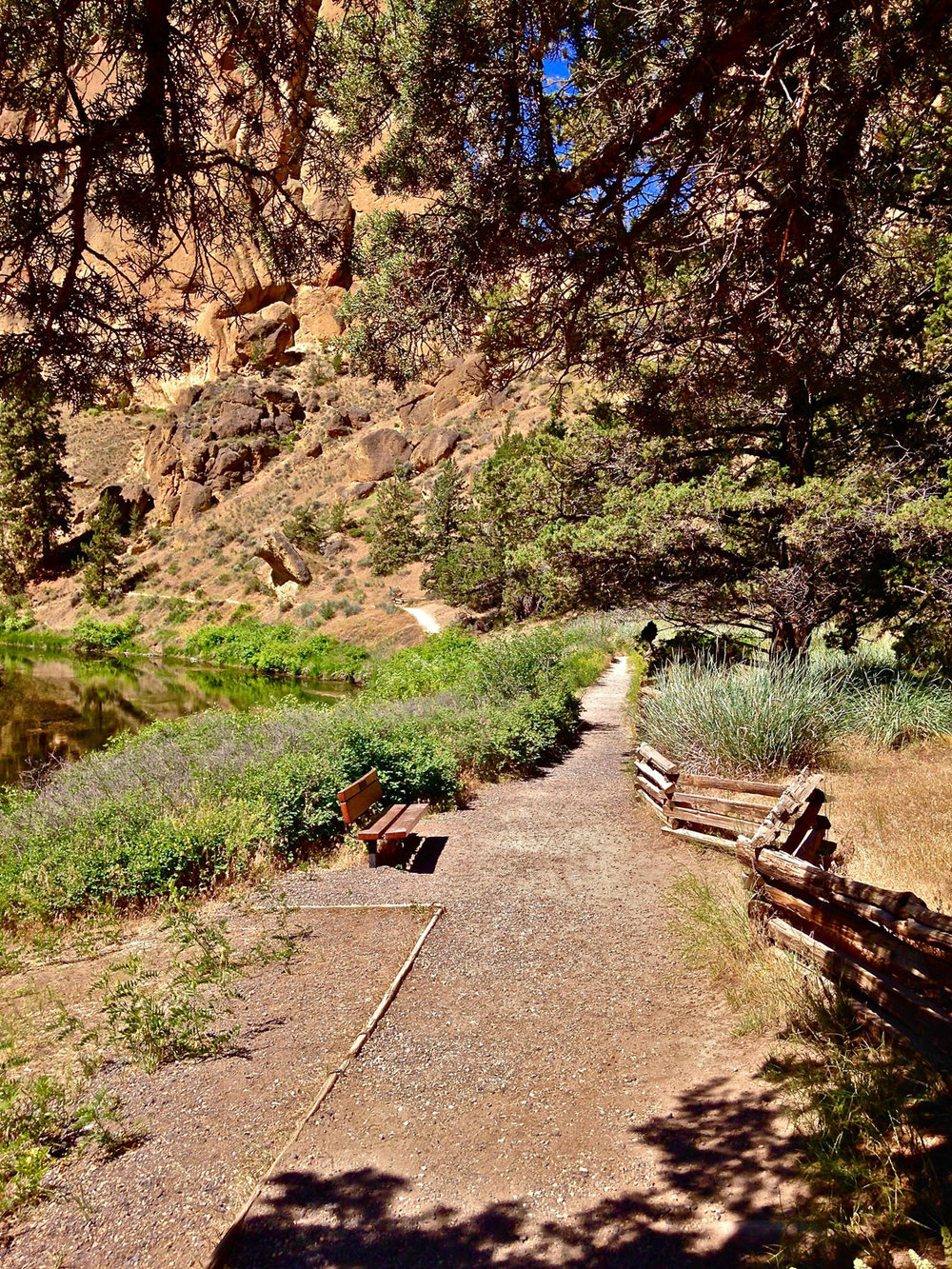 A bench on the River Trail and a trail up to a compost restroom allow you to hang out and watch the climbers at Smith Rock State Park.