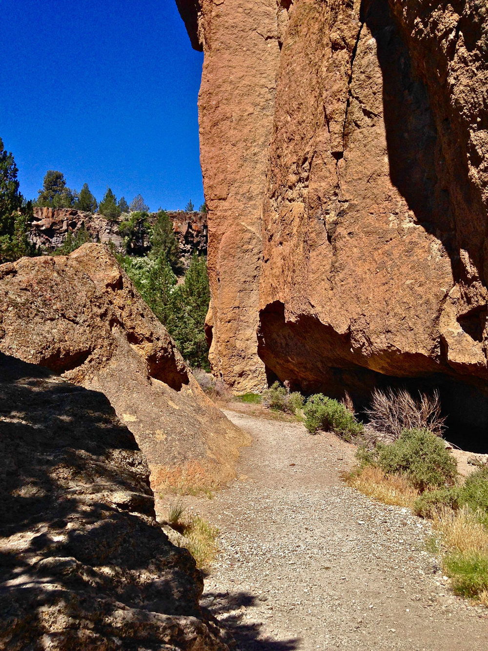 Natural caves with climbing routes nearby make for an interesting journey along the River Trail at Smith Rock State Park.
