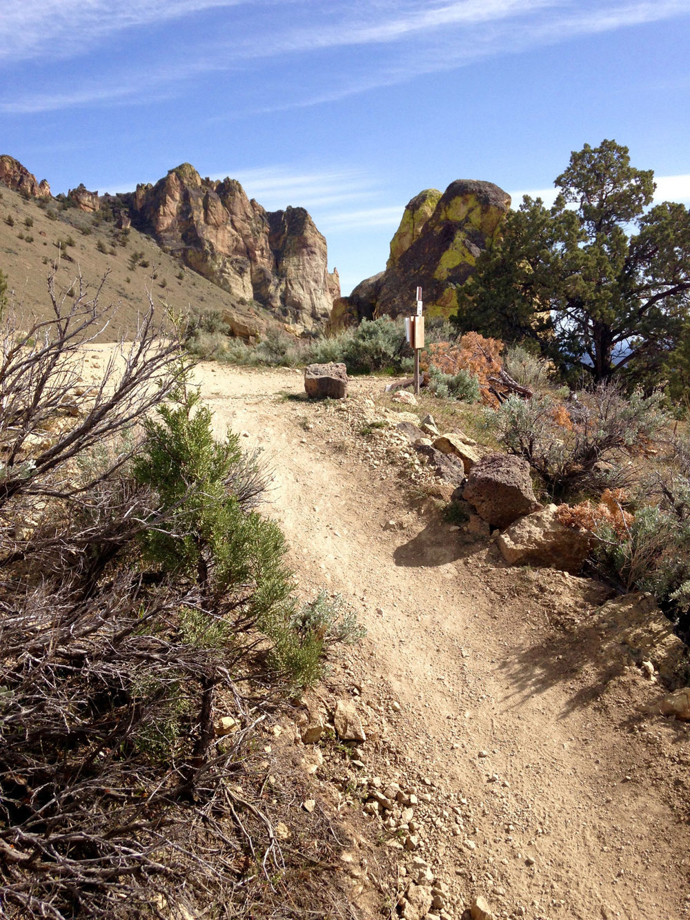 Finally the Summit Trail tops out at the summit of the Burma Road Trail. To do the Summit Trail Loop continue straight ahead and down the Burma Road back to Smith Rock State Park.