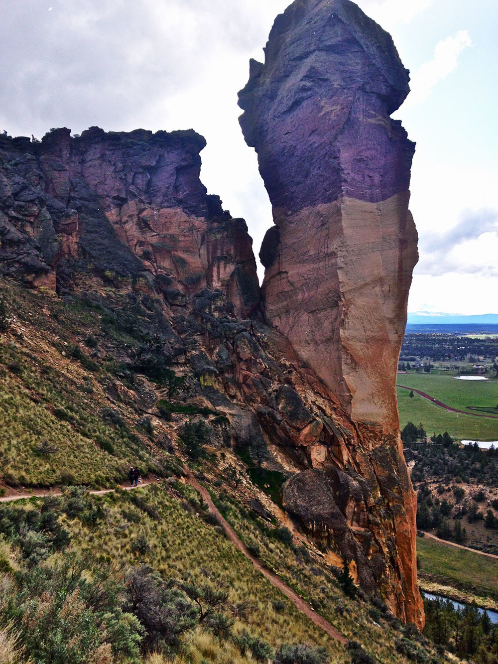 Monkey Face gets further away until the switchbacks take you back to the base on the Misery Ridge Trail at Smith Rock State Park.