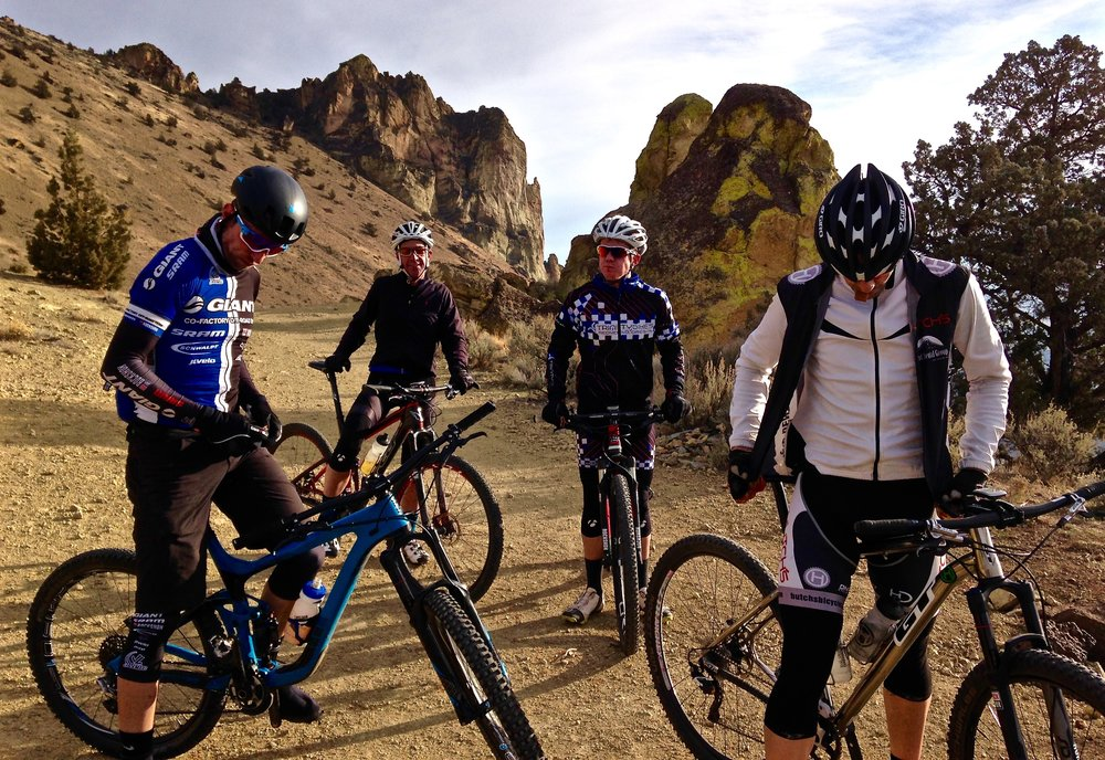 mountain bikers at the Summit Trail exit on the Burma Road summit by Smith Rock State Park