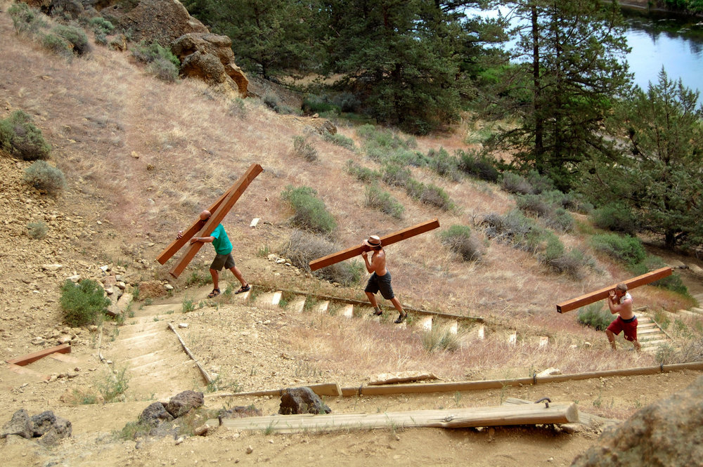 Smith Rock Spring Thing volunteers lug heavy materials up stairs to stabilize trails up even higher