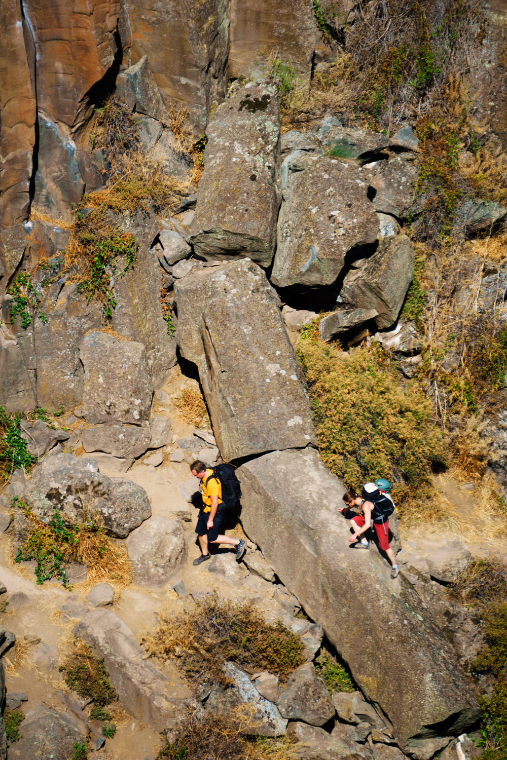 climbers at the base of the west side of the Lower Gorge at Smith Rock State Park