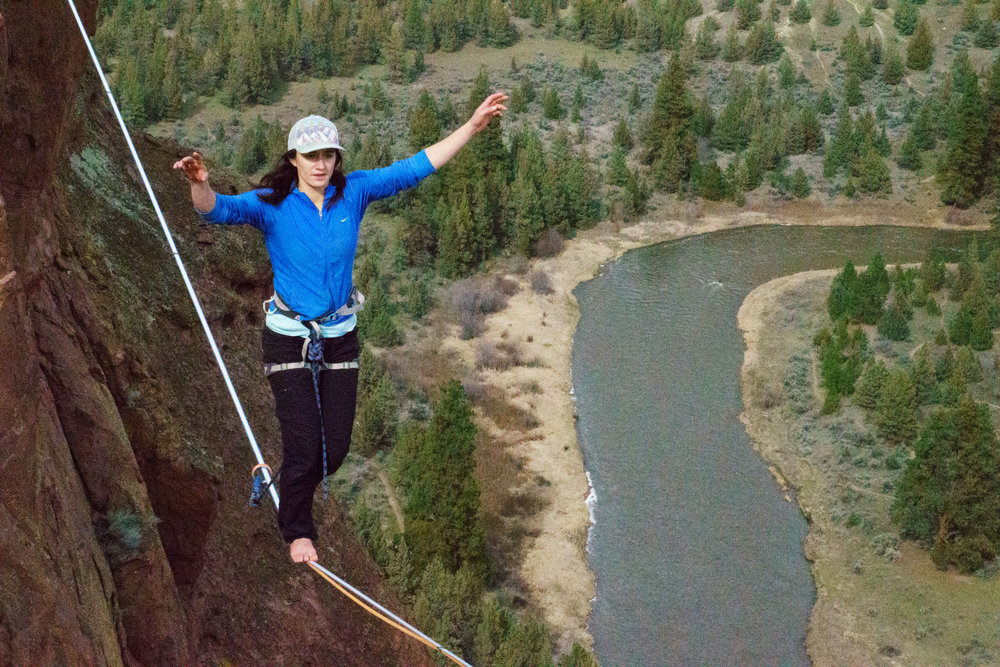 slackliner on Free Your Mind highline at Smith Rock State Park