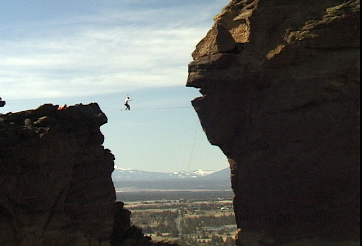 slackliner on Classic Monkey highline at Smith Rock State Park