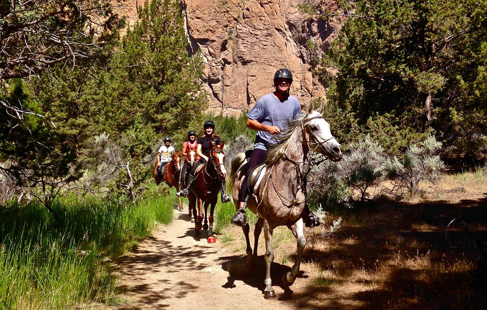 horseback riders on the Wolf Tree Trail at Smith Rock State Park