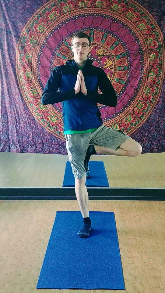 Alex teaching yoga at the Bend Rock Gym