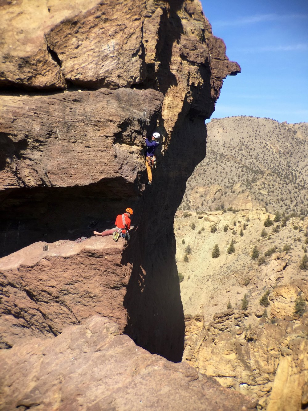 rock climbers  in the mouth of  Monkey Face  at Smith Rock State Park