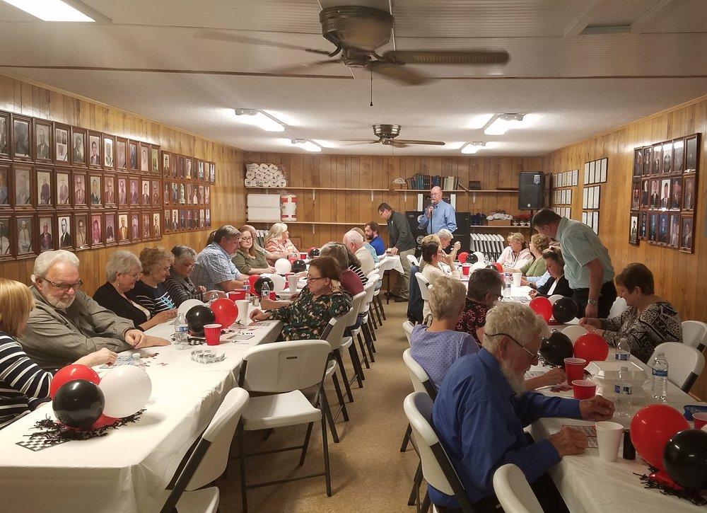 Attendees of the pot luck dinner enjoying a night of bingo!