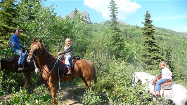 Horseback riding on the trails above the cabins.