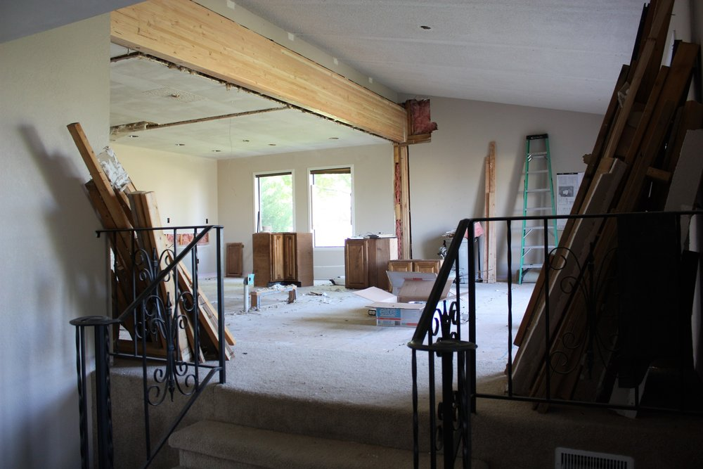 This is the view of our great room from the entryway! You can see our ENORMOUS support beam that our contractors installed in order to get rid of the walls holding the home up. That beam will get stained and look incredible in the space.
