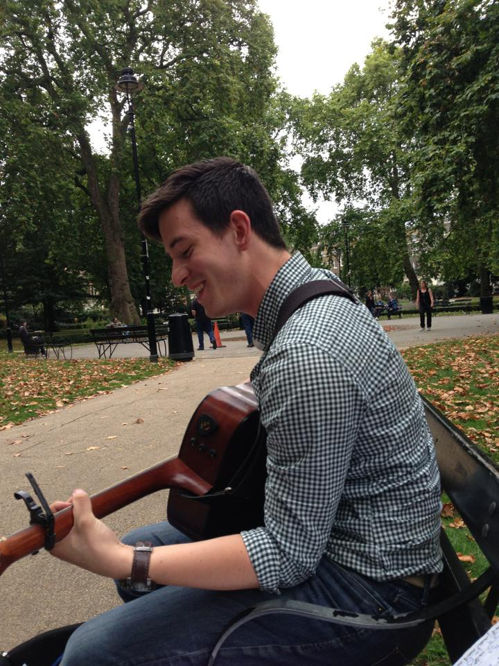 Max playing original music in London's Russell Square