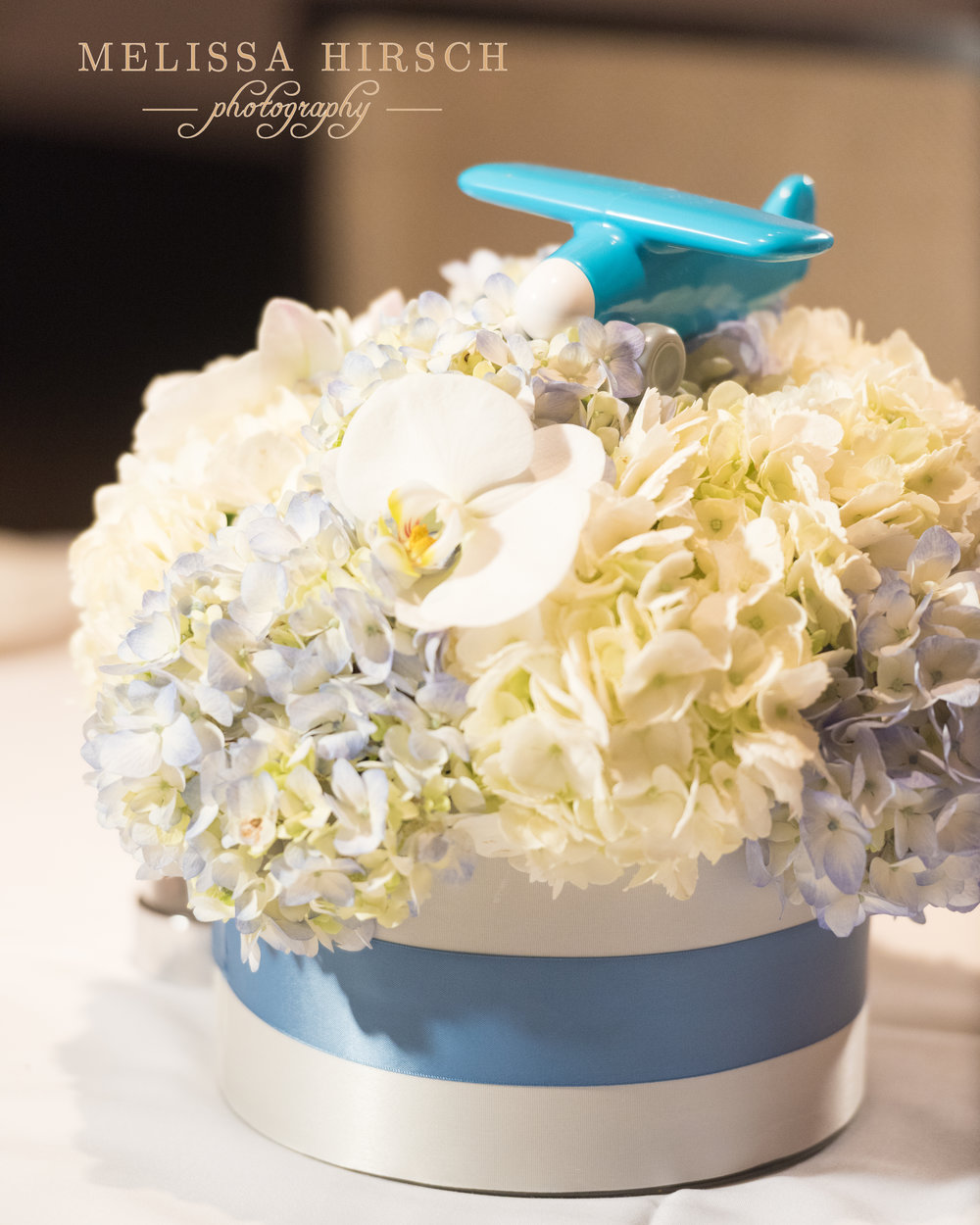 Gorgeous centerpieces by Newberry Brothers.