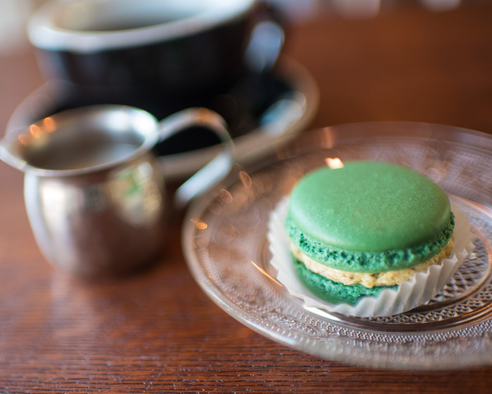 Pistachio macaroon at Devil's Food Bakery (the new one). Black Coffee in the background.