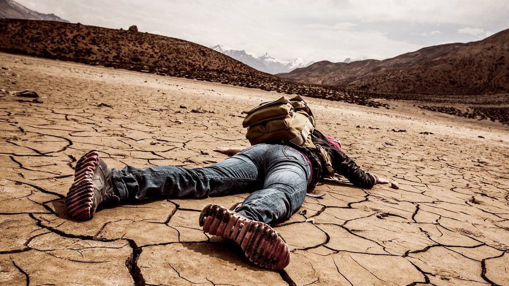 person-lays-on-the-dried-ground-507638826_3744x3744.jpg