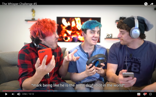 "[Image Description: Markiplier and two other guys sitting beside of each other. Craption says: ""*mark being like: he is the most deaf idiot in the world*"""