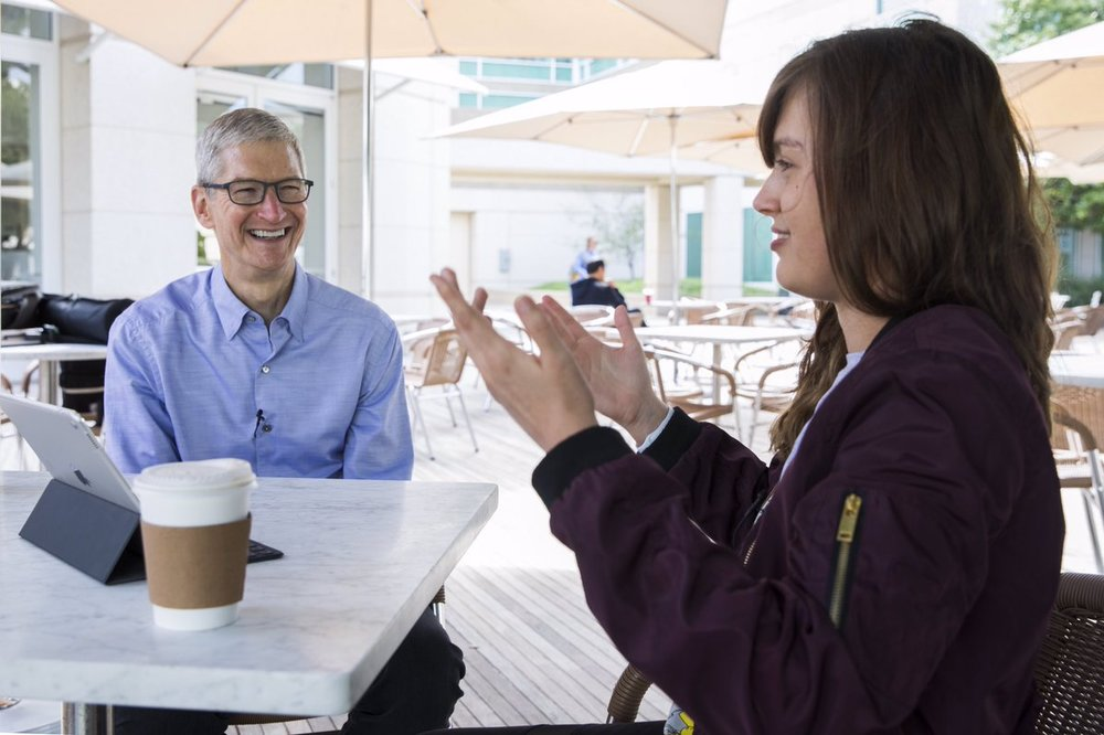 [Image Description: Tim Cook and Rikki Poynter sat down, engaged in conversation.]