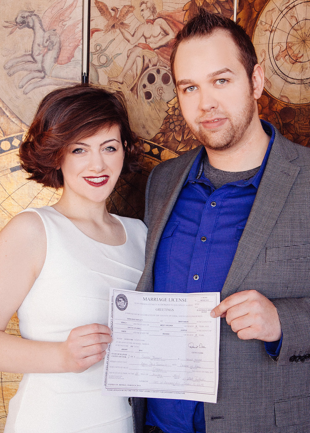 Newlyweds take a portrait with their Cook County marriage license