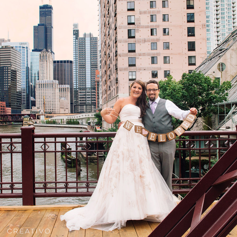 "8. Chicago elopement with a printed banner saying ""we eloped"""