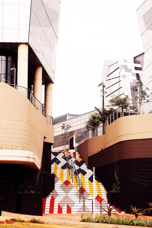 Colourway , tiled staircase artwork at Alice Lane Precinct (Paragon Architects), Sandton, Johannesburg, 2017. Project management by Parts&Labour. Graphic presentation by Counterspace Studio. Photograph : Dharmaratna Saraswa. Lorenzo Nassimbeni
