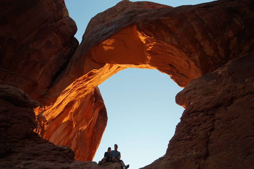 Sunsetting behind double arch